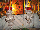 Silver filigree vigil lamps above Star of Bethlehem in Church of Nativity