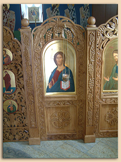 Iconostasis with silver vigil lamp